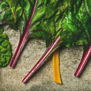 Flat lay of fresh green leaves of swiss chard Vegan food
