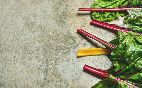 Flat lay of fresh leaves of swiss chard  copy space