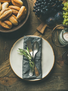 Fall table setting with cutlery and decoration top view