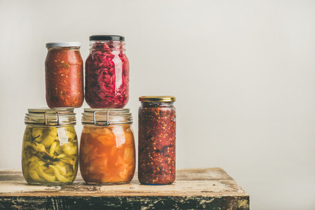 Autumn seasonal pickled or fermented vegetables in jars  copy space