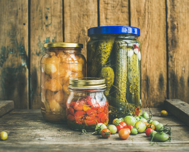 Autumn seasonal pickled vegetables and fruit in glass jars