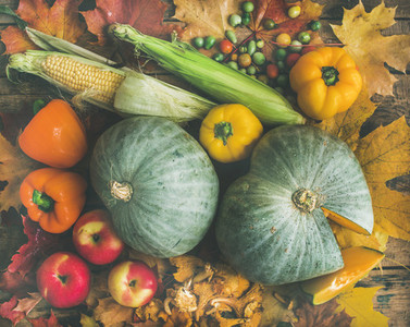 Fall vegetables assortment over wooden table background top view