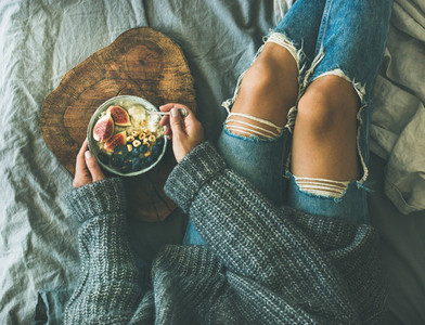 Healthy winter breakfast in bed concept top view