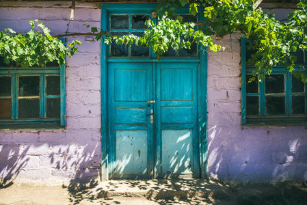 Purple wall and blue door of house  Turkey