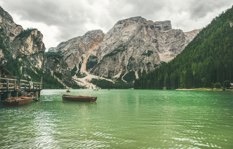 Mountain Lake in Valle di Braies and wooden boats