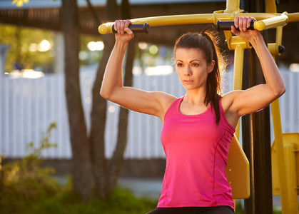 Woman in deep concentration while exercising