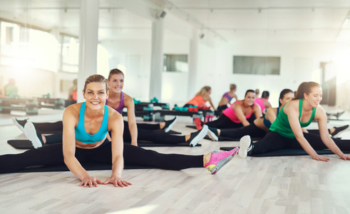 Group of fit women stretching