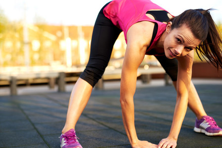 Woman doing a full body stretch and smile