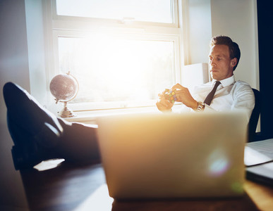 White executive business man sitting at his desk getting inspiration