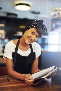 Smiling young coffee house owner