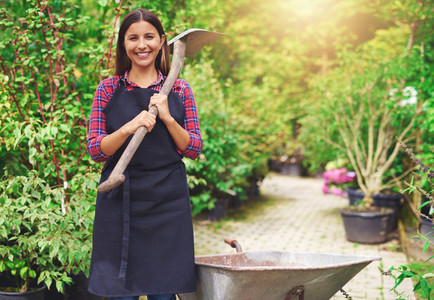 Happy young woman working at a commercial nursery