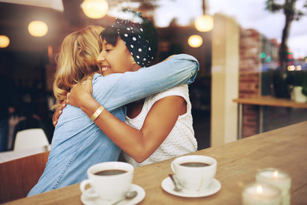 Two affectionate girl friends embracing