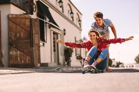 Woman enjoying a skateboard ride on the street