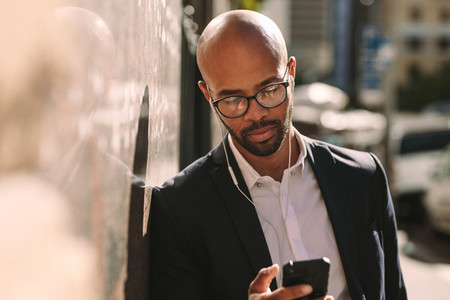 African businessman using mobile outside