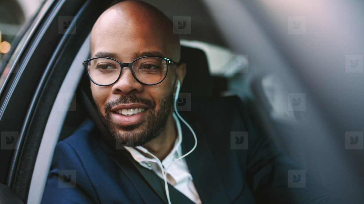 African business man driving car to office