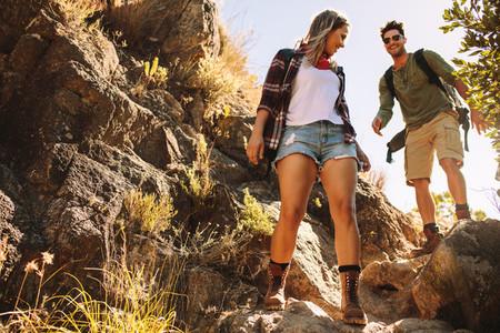 Couple hiking through extreme terrain