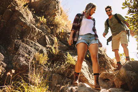 Couple hiking through extreme terrain