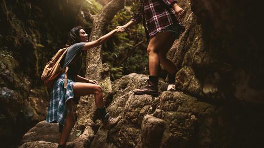 Women hiking through extreme terrain in mountain