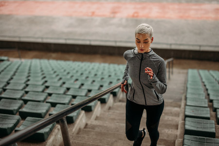 Fitness woman doing workout in  stadium