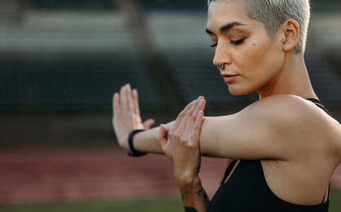 Close up of a fitness woman doing warm up exercises