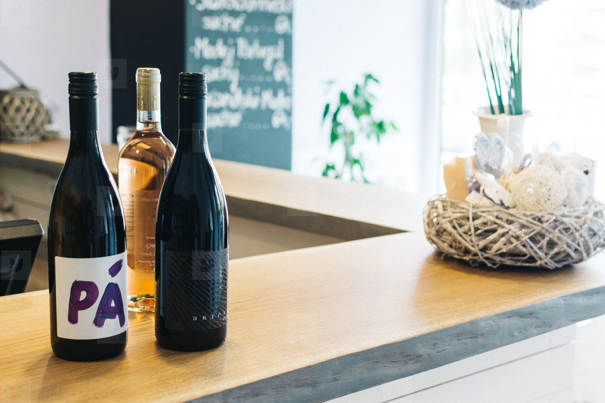 Bottles of wine on a wooden bar