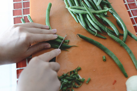 Cutting green bean pods