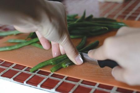 Cutting green bean pods