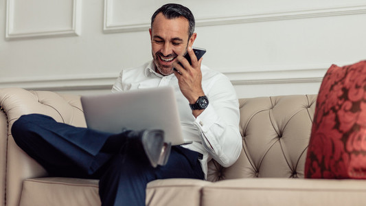 Businessman on tour working from hotel room