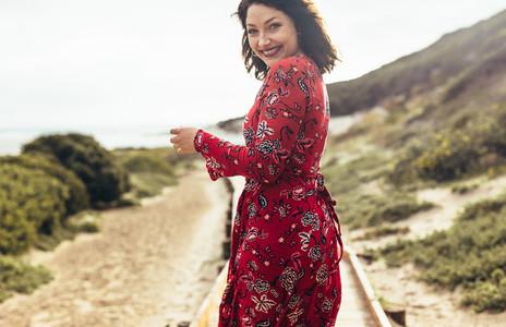 Beautiful woman walking at the seaside