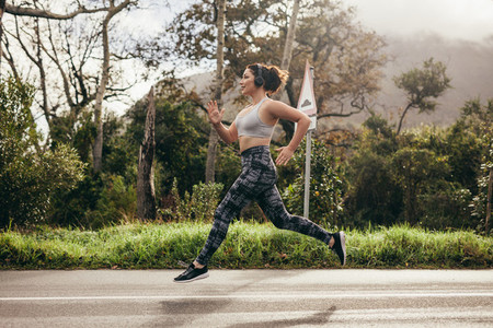 Female in sportswear running outdoors in morning