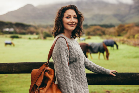 Beautiful woman standing in countryside
