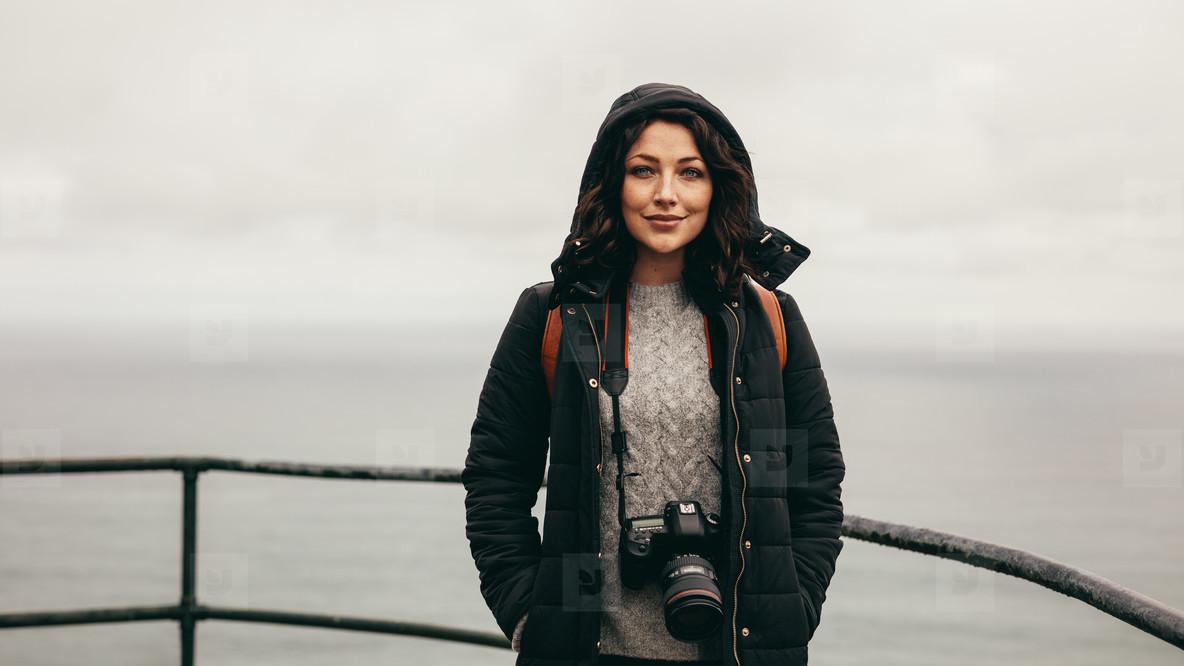 Female tourist by a hillside railing