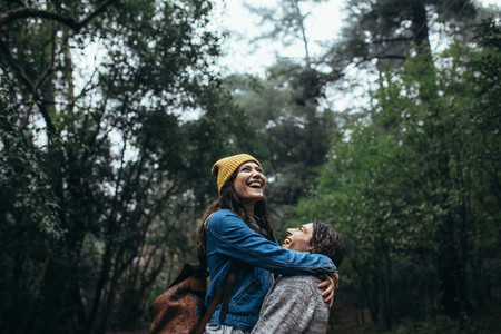 Couple having great time together in rain
