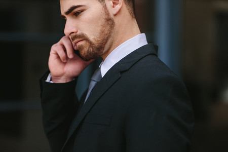 Businessman talking over mobile phone