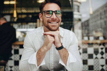 Smiling businessman sitting in a restaurant