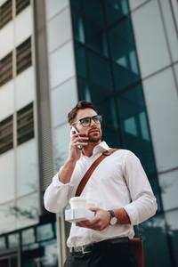 Entrepreneur talking on cell phone while walking on street