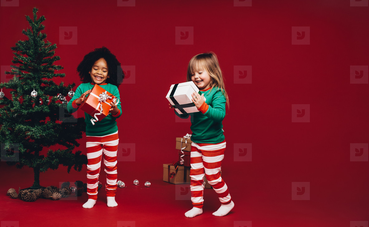 Happy kids looking at their gift boxes