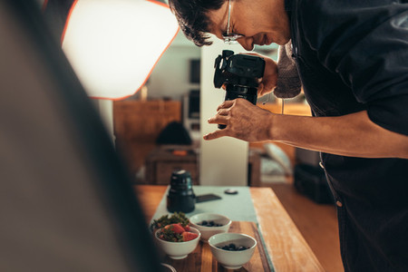 Photographer taking food pictures in studio