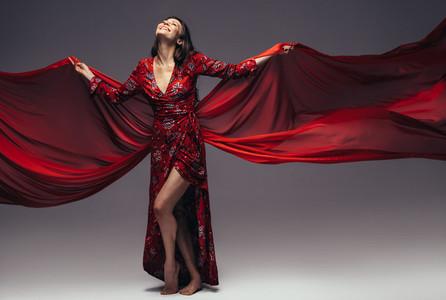 Beautiful woman in flying silk dress