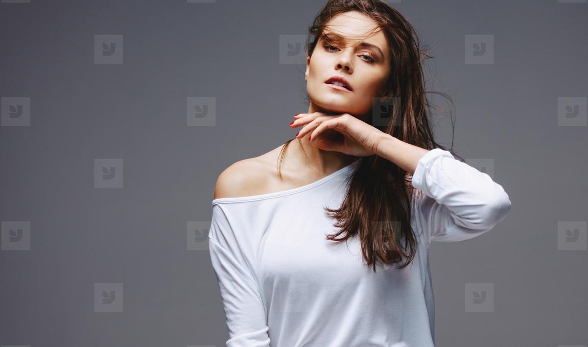 Beautiful woman posing on grey background