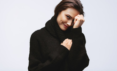 Pretty woman smiling in sweater