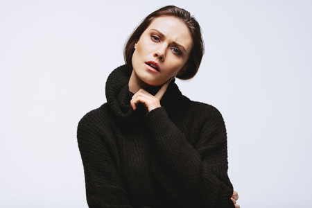 Thoughtful woman in black cardigan
