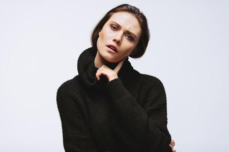 Thoughtful woman in black cardigan