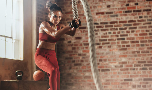 Woman exercising hard for perfect body