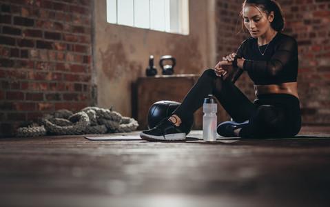 Woman tracking fitness progress on smart phone