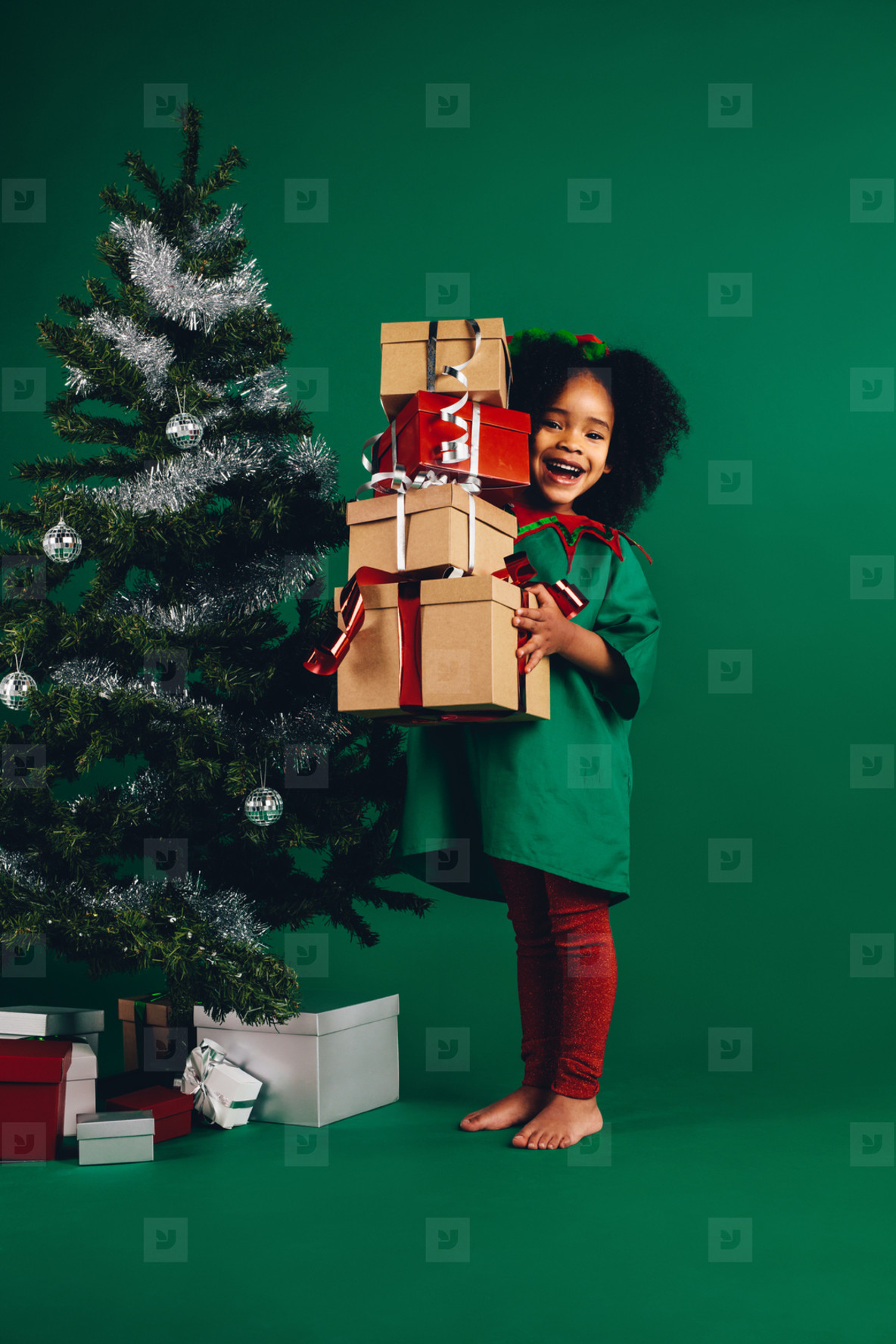 Photos - Little girl with her christmas gifts - YouWorkForThem