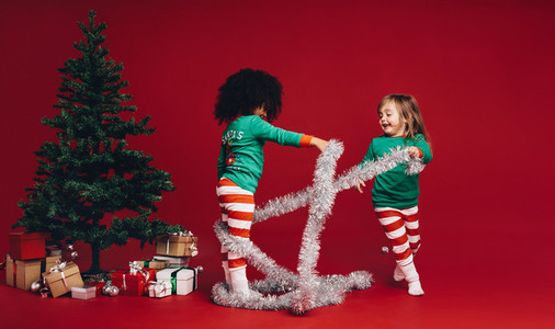 Children playing with decorative ribbon