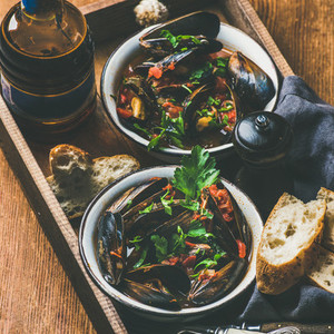 Belgian boiled mussels in and light beer in bottle