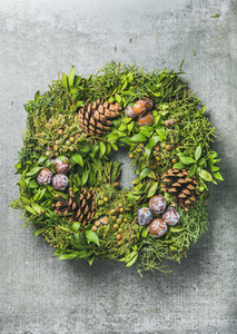 Christmas decorative wreath over grey concrete wall background
