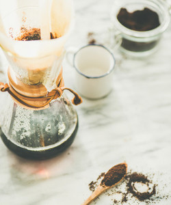 Black filtered coffee in Chemex on grey marble table background